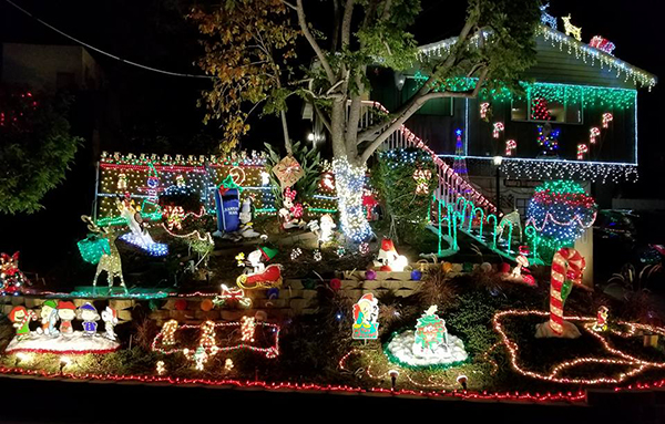 4037 N. Bonita St. Lots of lights, music, penguins, Snoopy, Mickey, Minnie  and Santa in the window. Dec. 10-Jan. 5, dusk-11 pm. - East County Christmas Lights