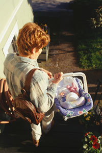 Use two hands to carry an infant carrier