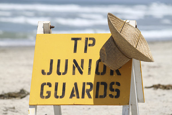 A sign that the Junior Lifeguards are present on the San Diego Beach.