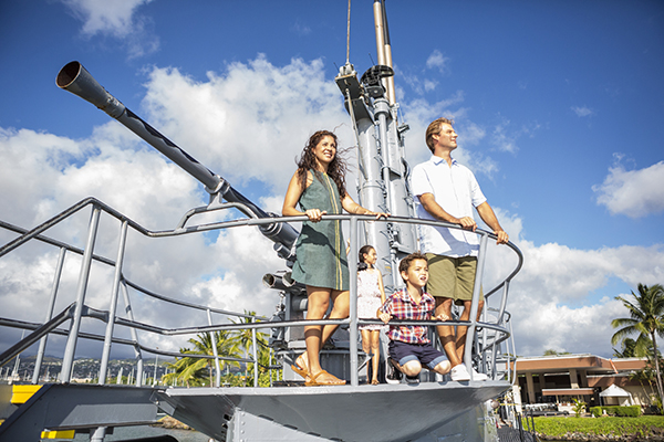 Folks like to stand next to the big gun at USS Bowfin Submarine Museum at Pearl Harbor