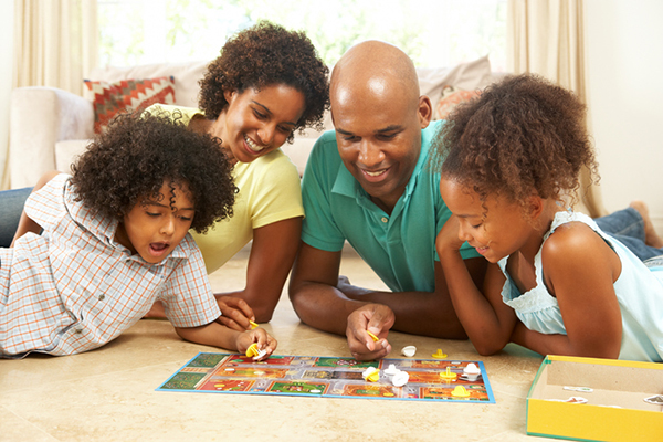 Family playing a favorite board game.